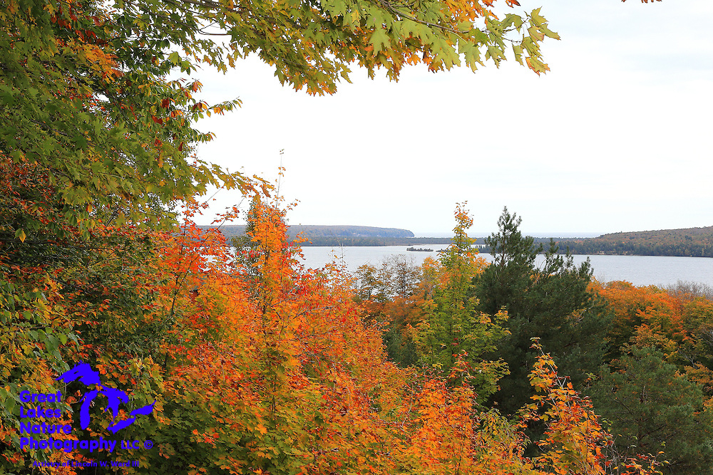 This shot was captured at the Grand Island Harbor Scenic Overlook. In addition to the pretty fall color, Murray Bay lies in the foreground, with Trout Bay and the huge Grand Island lies in the background. If only the sun had been out in full force!