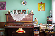 The hat of Eladio 'Don Pancho' Terry sits on his piano stool in his home. Don Pancho is Cuba's most revered Chekere player, as well as violinist and founding member of Las Maravillas de Florida, a charanga band who hit the height of their fame in the 70's. <br />