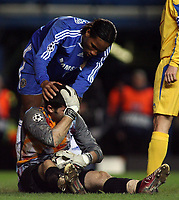 Photo: Paul Thomas.<br /> Chelsea v Levski Sofia. UEFA Champions League, Group A. 05/12/2006. <br /> <br /> Didier Drogba (Blue) of Chelsea checks to see if Keeper Bozhidar Mitrev is okay after they collide.