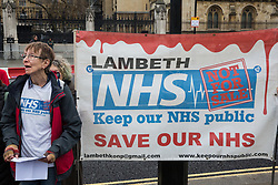 London, UK. 25 November, 2019. Gail, a nurse for forty years from the Lambeth Keep Our NHS Public campaign, addresses campaigners from Keep Our NHS Public, Health Campaigns Together, We Own It and Global Justice Now at a protest in Parliament Square to call on Prime Minister Boris Johnson to end privatisation of healthcare in the National Health Service (NHS).