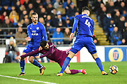 Bernardo Silva (20) of Manchester City goes down in the box after being challenged by Joe Bennett (3) of Cardiff City and Sean Morrison (4) of Cardiff City during the The FA Cup 4th round match between Cardiff City and Manchester City at the Cardiff City Stadium, Cardiff, Wales on 28 January 2018. Photo by Graham Hunt.