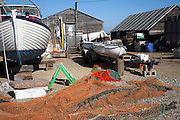 Fishing boats, nets and equipment, Felixstowe Ferry, Suffolk, England, UK