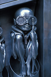 "This metal sculpture ""Alien Baby"" was on display in Switzerland..Swiss graphic artist Hans Rüdi Giger is best known for his design work on the film Alien. He is also well known for art work on a number of big-selling records including Emerson Lake and Palmer's Brain Salad Surgery. His style is disturbing and heavily laden with sexual imagery."
