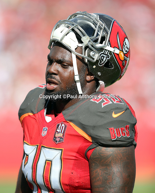 Tampa Bay Buccaneers defensive tackle Henry Melton (90) has a sideline conversation during the 2015 week 14 regular season NFL football game against the New Orleans Saints on Sunday, Dec. 13, 2015 in Tampa, Fla. The Saints won the game 24-17. (©Paul Anthony Spinelli)