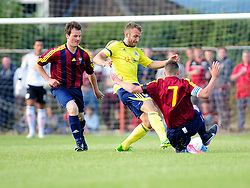 Bristol City's Liam Kelly is tackled - Photo mandatory by-line: Dougie Allward/JMP - Tel: Mobile: 07966 386802 03/07/2013 - SPORT - FOOTBALL - Bristol -  Ashton and Backwell United V Bristol City - Pre Season Friendly