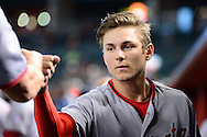 PHOENIX, AZ - AUGUST 03:  Trea Turner #7 of the Washington Nationals fist bumps a teammate prior to the game against the Arizona Diamondbacks at Chase Field on August 3, 2016 in Phoenix, Arizona. The Washington Nationals beat the Arizona Diamondbacks 8 to 3.  (Photo by Jennifer Stewart/Getty Images)