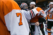 RIT goaltender Mike Rotolo and Robert Morris goaltender Terry Shafer, both Rochester natives shake hands after RIT defeated Robert Morris to win the Atlantic Hockey final at the Blue Cross Arena in Rochester on Saturday, March 19, 2016.