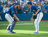 Sep 26, 2015; Toronto, Ontario, CAN; Toronto Blue Jays relief pitcher Roberto Osuna (54) and catcher Russell Martin (55) celebrate victory over Tampa Bay Rays at Rogers Centre. Jays beat Rays 10 - 8. Mandatory Credit: Peter Llewellyn-USA TODAY Sports