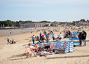 Holidaymakers enjoying sunshine on the sandy beach at Weymouth, Dorset, England