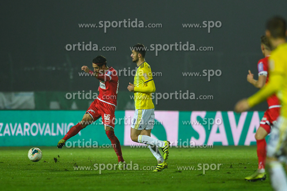 Ilija Martinović of Aluminij and Rok Kronaveter of Maribor during football match between NK Aluminij and NK Maribor in 18th Round of Prva liga Telekom Slovenije 2019/20, on November 24, 2019 in Sportni park Aluminij, Kidricevo Slovenia. Photo by Milos Vujinovic / Sportida