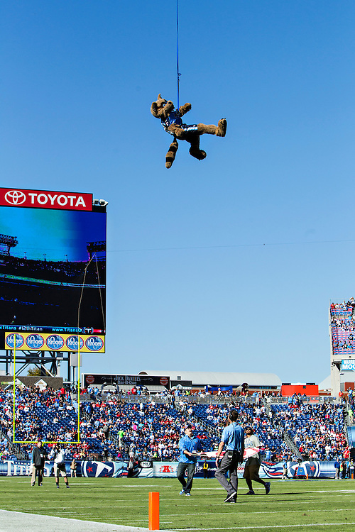 NASHVILLE, TN - OCTOBER 20:  T-Rex of the Tennessee Titans drops into the stadium before a game against the San Francisco 49ers at LP Field on October 20, 2013 in Nashville, Tennessee.  The 49ers defeated the Titans 31-17.  (Photo by Wesley Hitt/Getty Images) *** Local Caption ***