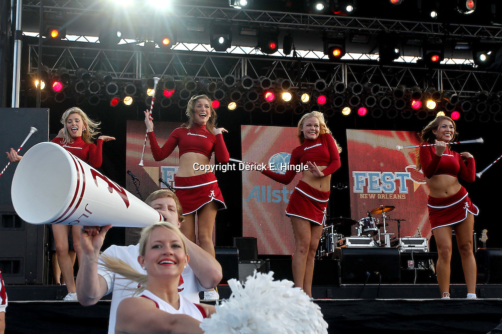 January 8, 2012; New Orleans, LA, USA;  Alabama Crimson Tide cheerleaders perform during the Fan Fest pep rally in the French Quarter for the 2012 BCS National Championship game to be played on January 9, 2012 between the Alabama Crimson Tide and the LSU Tigers at the Mercedes-Benz Superdome.  Mandatory Credit: Derick E. Hingle-US PRESSWIRE