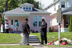 Teresa Hawkins, right and Willie Clarkson stop on the way to church to see the Muhammad Ali Boyhood Home memorial, Sunday, June 05, 2016.<br /> <br /> Legendary heavyweight boxing champion Muhammad Ali, a Louisville, Ky. native, died Friday, June 3, 2016. Murals and tributes could be seen across his hometown as people mourned the charismatic sports figure.