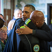 President Barack Obama hugs County Executive John Lovick as Obama visits the Oso Fire Station to speak with rescuers near the scene of the deadly Oso mudslide.