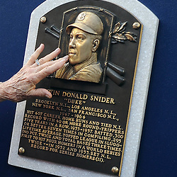 Bev Snider, wife of the late hall of famer, Brooklyn and Los Angeles Dodgers Duke Snider touches the Hall of fame plaque as the Dodgers honored Snider prior to a baseball game against the Philadelphia Phillies in Los Angeles on Tuesday, August 9, 2011. (SGVN/Staff Photo by Keith Birmingham/SPORTS)