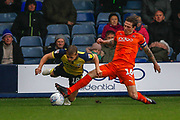 Luton Town defender Glen Rea (16) tackles Scunthorpe United forward George Thomas (18), on loan from Leicester, City, during the EFL Sky Bet League 1 match between Luton Town and Scunthorpe United at Kenilworth Road, Luton, England on 6 October 2018.