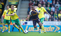 NORWICH, ENGLAND - Saturday, September 29, 2012: Liverpool's Raheem Sterling dances through the Norwich City defence during the Premiership match at Carrow Road. (Pic by David Rawcliffe/Propaganda)
