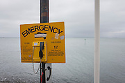A seascape looking towards the Thames estuary, with an Emergency telephone on the Western Esplanade at Southend.