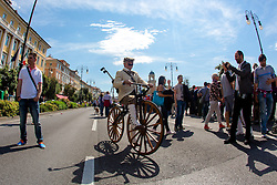 Fan with vintage bicycle during the 172 km long 21st stage from Gemona del Friuli to Trieste at 97th Giro d'Italia 2014, on 1st June, 2014 in Trieste, Italy. (Photo by Matic Klansek Velej / Sportida.com)