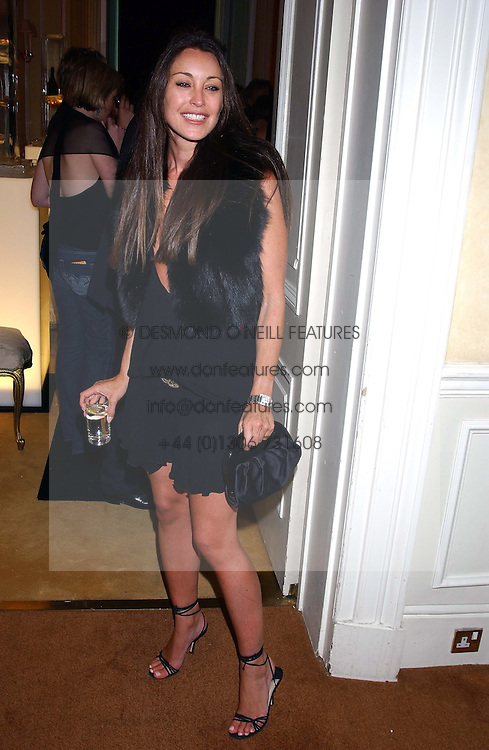 TAMARA MELLON at a party hosted by Dom Perignon and Vanity Fair magazine to celebrate the launch of a unique collection of essays based on the theme of seduction to raise money for the charity English Pen. The paty was held at the Dom Perignon Mallroom,  13 Grosvenor Crescent, London W1 on 8th September 2004.
