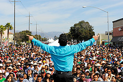 "The lead singer of the popular band ""Tentacion"" takes in the crowd's appreciation just before the reenactment of ""El Grito,"" or ""The Cry of Independence"" in Salinas. Sunday's crowds along East Alisal celebrated the symbolic beginning of Mexico's revolution against Spanish rule."