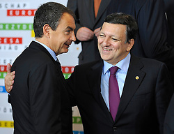 "Jose Zapatero, Spain's prime minister, left, is greeted by Jose Manuel Barroso, president of the European Commission, during the ""Family Photo"" session at the European Summit, in Brussels, Belgium, Wednesday, Oct. 15, 2008.   (Photo © Jock Fistick)"