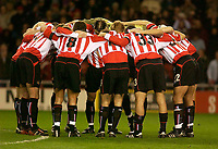 Photo. Glyn Thomas.<br /> Sunderland v Birmingham. FA Cup fifth round.<br /> Stadium of Light, Sunderland. 14/02/2004.<br /> Sunderland's players were determined to put in a solid performance.