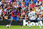 Crystal Palace defender Mamadou Sakho (12) goes past Tottenham Hotspur defender Serge Aurier (24) during the Premier League match between Tottenham Hotspur and Crystal Palace at Tottenham Hotspur Stadium, London, United Kingdom on 14 September 2019.
