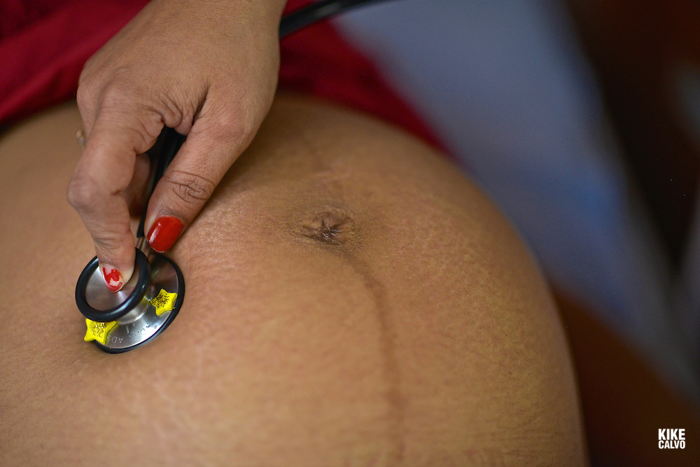 Doctor checking the health of a pregnant mother in Central America.