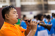 06 FEBRUARY 2014 - HAT YAI, SONGKHLA, THAILAND: A man plays a traditional Thai flute during Lunar New Year at the Tong Sia Siang Tueng temple in Hat Yai. Hat Yai was originally settled by Chinese immigrants and still has a large ethnic Chinese population. Chinese holidays, especially Lunar New Year (Tet) and the Vegetarian Festival are important citywide holidays.     PHOTO BY JACK KURTZ