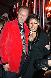 JOE CORRE son of Vivienne Westwood, his wife SERENA REES at a party and fashion show by Agent Provocateur at the Cafe de Paris, Coventry Street, London W1 on 14th February 2005.<br />