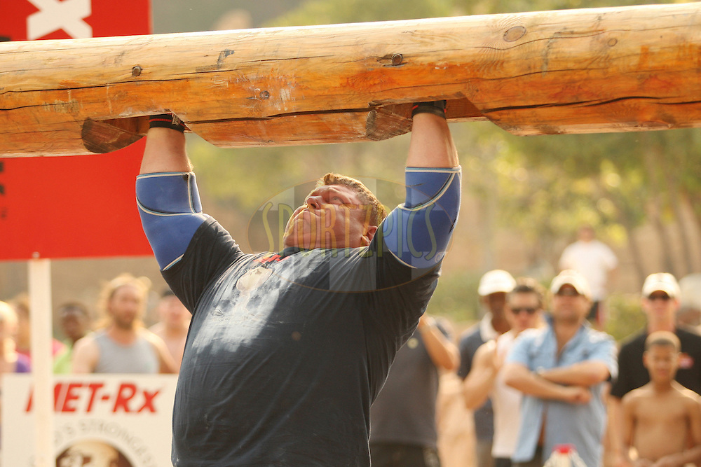 Defending champion Zydrunas Savickas (Lithuania) shows his strength the overhead log-lift during the final rounds of the World's Strongest Man competition held in Sun City, South Africa.