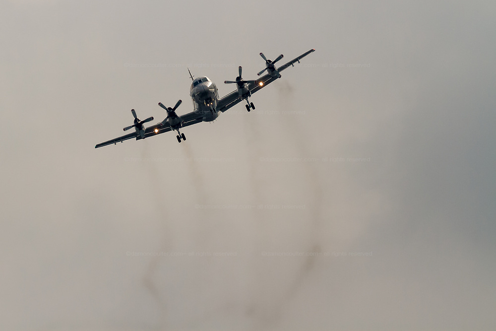 A Lockheed P-3C Orion Maritine reconnaissance aircraft flying with the Japanese Maritime Self Defence Force flies over Chou Rinkan in Kanagawa, Japan. Tuesday May 31st 2016