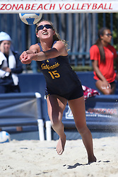 April 7, 2018 - Tucson, AZ, U.S. - TUCSON, AZ - APRIL 07: California Golden Bears Madison Dueck (15) hits the ball during a college beach volleyball match between the California Golden Bears and the Arizona Wildcats on April 07, 2018, at Bear Down Beach in Tucson, AZ. Arizona defeated California 3-2. (Photo by Jacob Snow/Icon Sportswire (Credit Image: © Jacob Snow/Icon SMI via ZUMA Press)