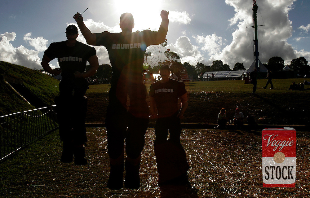 Performers dressed as security guards at the Great Escape music festival in Sydney, Sunday, April 8, 2007. The festival is in its second year and runs over the Easter long weekend. (AAP Image/Megan Young) NO ARCHIVING