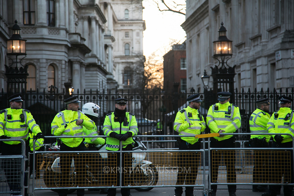 Protesters agains the visit by Saudi prince Bin Salman gather opposite Downing Street March 7th 2018 in London, United Kingdom. Police protec Downing Street 10. Many are angry at the Saudi involvement and continued bombing in Yemen with tens of thousands of civilian casualties and many more displaced by the war.