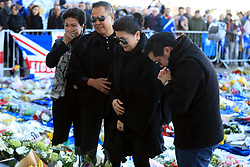 Aiyawatt Srivaddhanaprabha son of Leicester Chairman lays a wreath in memory of his father with his mother Aimon (second right). Vichai Srivaddhanaprabha, was among those to have tragically lost their lives on Saturday evening when a helicopter carrying him and four other people crashed outside King Power Stadium.