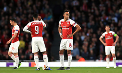 Arsenal's Pierre-Emerick Aubameyang (second right) and Alexandre Lacazette (second left) appear dejected after Valencia's Mouctar Diakhaby (not pictured) scores his side's first goal of the game during the UEFA Europa League Semi final, first leg match at The Emirates Stadium, London.