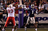Kansas State quarterback Josh Freeman (1) throws down field under pressure from Nebraska's Ndamukong Suh (93) at Bill Snyder Family Stadium in Manhattan, Kansas, October 14, 2006.  The Huskers beat the Wildcats 21-3.<br />