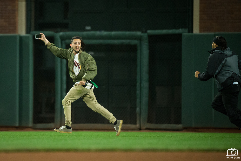 A man runs around the field during a MLB preseason game between the San Francisco Giants and Oakland Athletics at AT&T Park in San Francisco, California, on March 30, 2017. (Stan Olszewski/Special to S.F. Examiner)