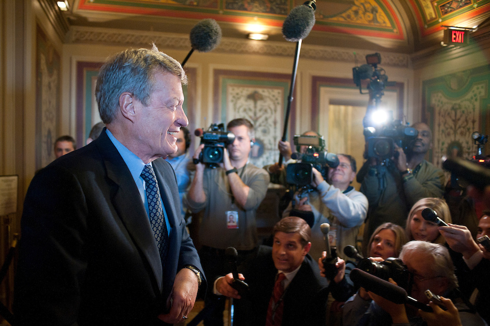 """Senator MAX BAUCUS (D-MT) bypasses the media following a meeting of the Democratic members of the Deficit Reduction """"Supercommittee"""" on Capitol Hill on Thursday."""