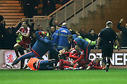 CORRECTION:- Middlesbrough celebrate Middlesbrough midfielder Adam Forshaw (34)  last minute score a goal and celebrates to make the score  2-1 during the Sky Bet Championship match between Middlesbrough and Reading at the Riverside Stadium, Middlesbrough, England on 12 April 2016. Photo by Simon Davies.