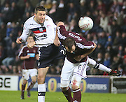 Dundee's Colin Nish  out jumps Hearts' Andy Webster  - Hearts v Dundee in the Clydesdale Bank, Scottish Premier League at Tynecastle.. - © David Young - www.davidyoungphoto.co.uk - email: davidyoungphoto@gmail.com
