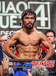 LAS VEGAS, NV - DEC 7: Boxers Manny Pacquiao (54-4-2, 38 KO) and Juan Manuel Marquez (54-6-1, 39 KO) at the Pacquiao vs Marquez 4 Weigh In at the MGM Grand Garden Arena in Las Vegas, NV. Manny Pacquiao stopped the scale at 147 lbs and Juan Manuel Marquez stopped the scale at 143 lbs. Byline and/or web usage link must  read PHOTO: © Eduardo E. Silva/SILVEX.PHOTOSHELTER.COM.