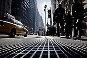 On the ground on a sidewalk of 7th avenue in Midtown Manhattan, New York, 2009.