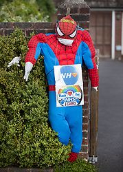 © Licensed to London News Pictures. 27/04/2020. Capel, UK. A scarecrow depiction of Spiderman thanking the NHS stands at the front of a house in the Surrey village of Capel. Residents of the village have resurrected their summer tradition of scarecrows in tribute to NHS medical staff and other key workers. Up to 30 of the life size home made doll like characters can be seen in front gardens throughout the village. The public have been told they can only leave their homes when absolutely essential, in an attempt to fight the spread of coronavirus COVID-19 disease. Photo credit: Peter Macdiarmid/LNP