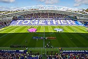 Panoramic American Express Community Stadium showing the 'together' message held up by fans before the Sky Bet Championship match between Brighton and Hove Albion and Hull City at the American Express Community Stadium, Brighton and Hove, England on 12 September 2015.