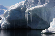 Crystal Sound, Antarctic Peninsula, Antarctica - Icicles hang from an iceberg floating in Crystal Sound along the Antarctic Peninsula.<br />  &copy;Ann Inger Johansson/zReportage/Exclusivexpix media