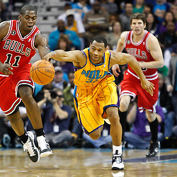 February 12, 2011; New Orleans, LA, USA; Chicago Bulls shooting guard Ronnie Brewer (11) steals the ball from New Orleans Hornets shooting guard Willie Green (33) during the fourth quarter at the New Orleans Arena.  The Bulls defeated the Hornets 97-88. Mandatory Credit: Derick E. Hingle