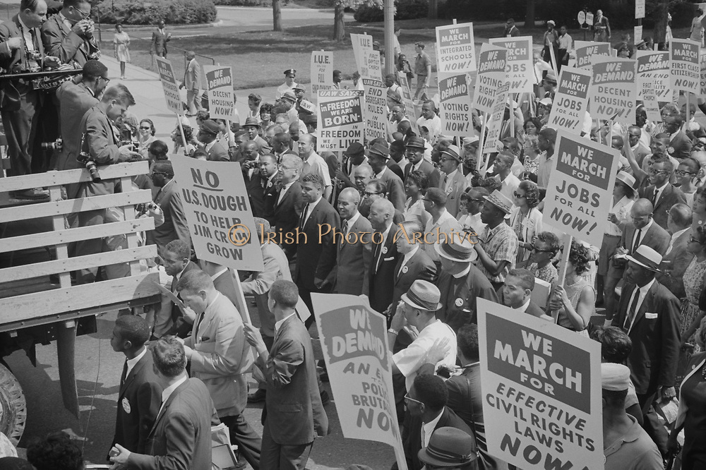 Civil rights march on Washington, DC, USA.  Civil rights leaders, including Martin Luther King, Jr, surrounded by crowds carrying signs.  28 August 1968. Photographer:  Warren K  Leffler.